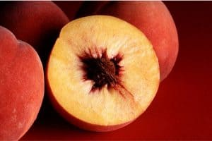 Why do I need to be cautious while having peaches during pregnancy?