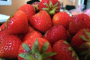 Does excess consumption of strawberries during pregnancy induce labour?