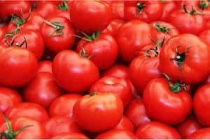 How do tomatoes help during pregnancy?